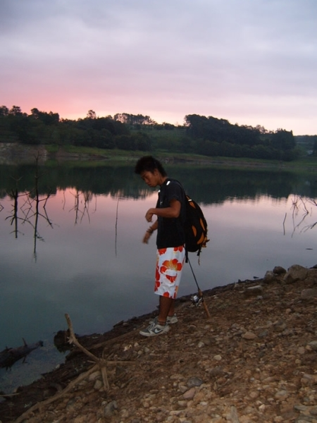 There are worse things in life than watching a sunrise with a fishing rod in your hand next to a glassy lake!