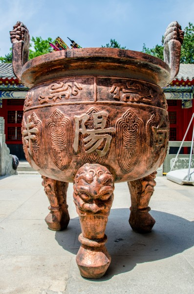 This large incense urn bears the temple's hanzi name in the traditional right-to-left order: 向 阳 寺